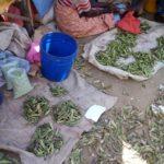 BURUNDI : Une légumière - commerçante du marché de KIVYUKA, MUSIGATI / BUBANZA